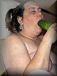 Nancy sucks a cucumber
