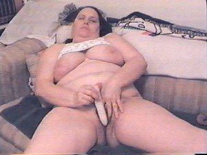 Nancy uses her dildo on her hairy pussy